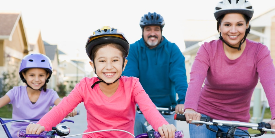 Family riding bicycles together --- Image by © Steve Hix/Somos Images/Corbis
